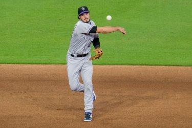 Rockies' Nolan Arenado Throws Toward First Base.