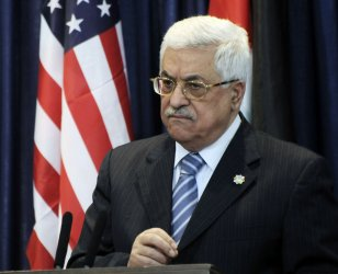 U.S. Secretary of State Hillary Clinton and Palestinian Mahmoud Abbas hold a joint press conference in Ramallah, West Bank