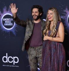 Thomas Rhett and Lauren Akins attend American Music Awards in LA