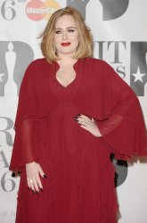 Adele attends the Brit Awards in London
