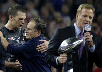 Patriots coach Bill Belichick and Tom Brady embrace