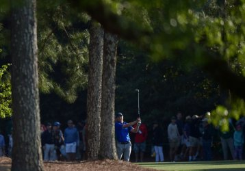 Jordan Spieth hits to the 18th green at the Masters