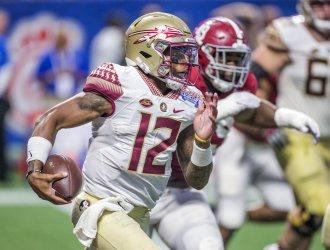 Florida State quarterback Deondre Francois scrambles against Alabama