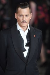 Johnny Depp attends the world premiere of Murder On The Orient Express at Royal Albert Hall.