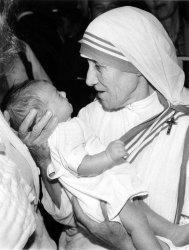 MOTHER TERESA HOLDING CHILD