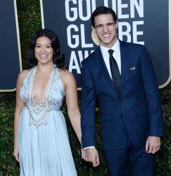 Gina Rodriguez and Joe Locicero attend Golden Globe Awards