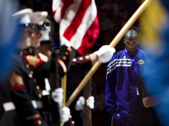 Lakers Bryant Stands for National Anthem During the NBA Western Conference Playoffs First Round Game Four in Denver