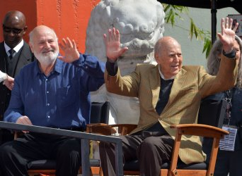 Carl and Rob Reiner immortalized in forecourt of TCL Chinese Theatre in Los Angeles