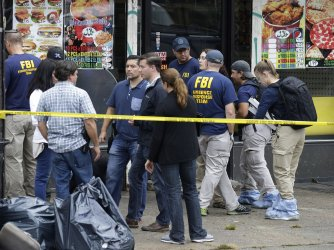 FBI and police gather outside First American Fried Chicken