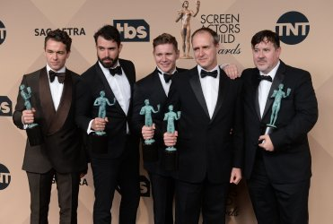 Julian Ovenden, Tom Cullen, Allen Leech, Kevin Doyle, and Jeremy Swift win an award backstage at the 22nd annual Screen Actors Guild Awards