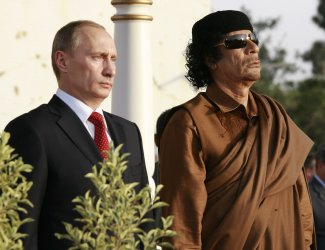 Russian President Putin and Libyan Leader Gadhafi meet in Tripoli