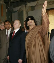 Russian President Putin and Libyan Leader Gadhafi meet in Tripoli