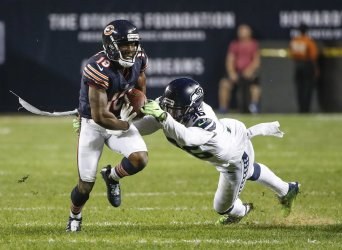 Taylor Gabriel of the Bears is tackled by Akeem King of the Seahawks in Chicago