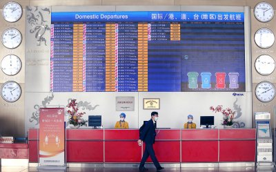 Workers Wear Face Masks at the Airport in Beijing, China