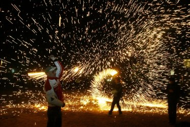Iranians celebrate fire jumping ceremony in Tehran
