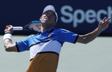 Kei Nishikori of Japan serves at the US Open