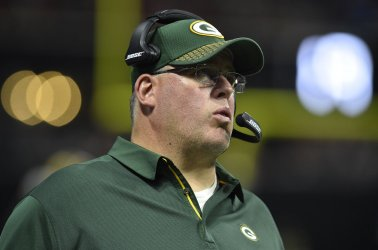 Packers head coach Mike McCarthy works sidelines against Falcons