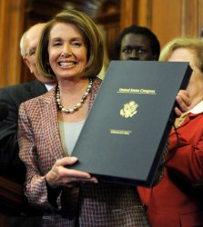 Pelosi signs Health Care and Education Reconciliation Act in Washington