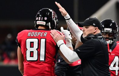 Falcons coach Dan Quinn celebrates with Austin Hooper after TD during an NFL game in Atlanta