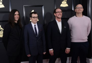 Brian Bell, Rivers Cuomo, Scott Shriner, and Patrick Wilson arrive for the 59th annual Grammy Awards in Los Angeles