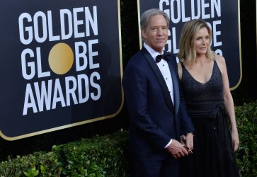 David E. Kelley and Michelle Pfeiffer attend the 77th Golden Globe Awards in Beverly Hills
