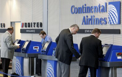 Passengers on United and Continental check in at O'Hare Airport in Chicago