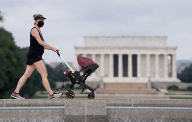 A woman wears a mask on the National Mall in Washingotn, DC