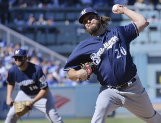 Brewers starter Miley throws to one batter in first inning in NLCS Game Five