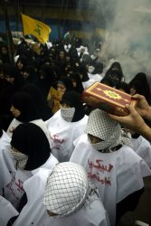 Iranian volunteer militia gets ready to fight against Israeli forces in Gaza