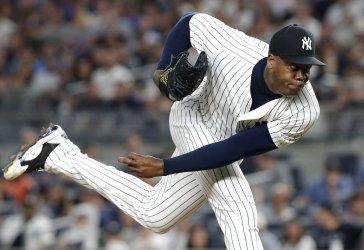 New York Yankees closer Aroldis Chapman throws a pitch