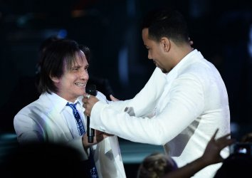 Roberto Carlos and Romeo Santos at the Person of the Year tribute in Las Vegas