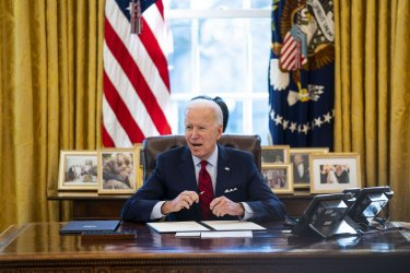 Biden Signs Executive Orders Regarding Health Care in the Oval Office