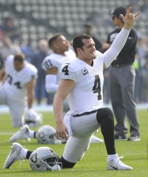 Raiders quarterback Derek Carr warms up before the game against the Chargers in Carson, California