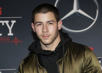 Nick Jonas  arrives on the red carpet at ESPN Party