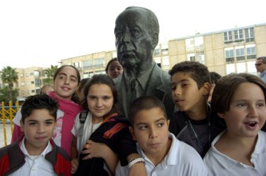 ISRAELI CHILDREN STAND BY A STATUE OF THE LATE ISRAELI PRIME MINISTER YITZHAK RABIN IN TEL AVIV