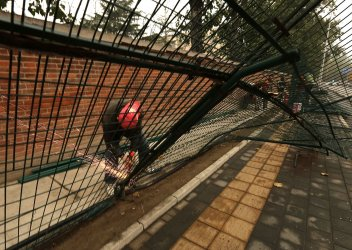 Chinese erect new fence around North Korean embassy in Beijing