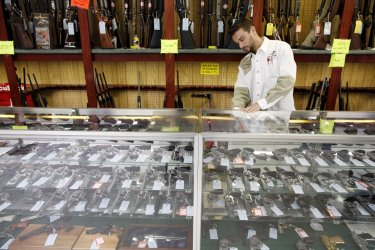 Tropino shows handguns at shop in Dundee, Illinois