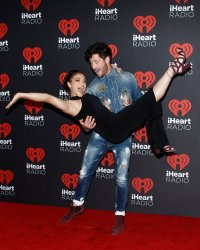Laurie Hernandez and Val Chmerkovskiy arrive for the iHeartRadio Music Festival