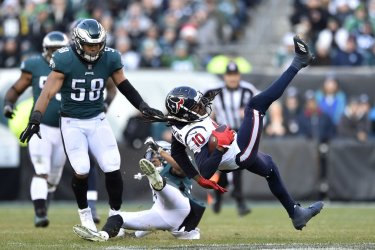 Texans' DeAndre Hopkins is up ended by Eagles safety Tre Sullivan