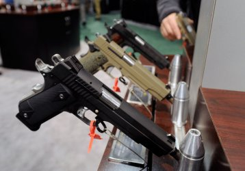 Hand guns on display at the 35th annual SHOT Show