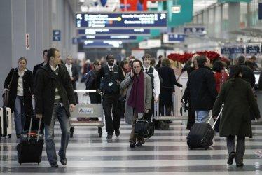 Passengers walk through airport in Chicago