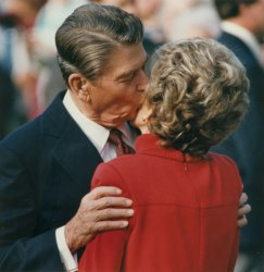 Ronald Reagan kisses his wife Nancy Reagan