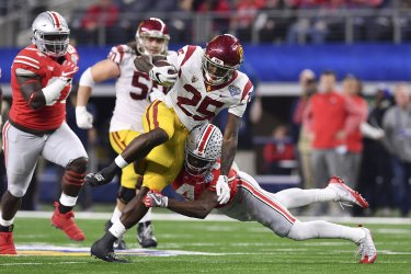 USC Trojans running back Ronald Jones II #25 is tackled in the Goodyear Cotton Bowl Classic