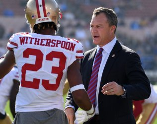 Niners General Manager John Lynch embraces Ahkello Witherspoon prior to game against the Rams