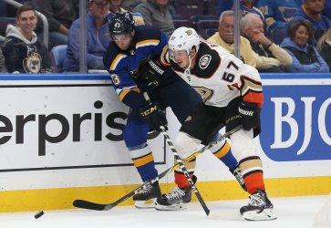St. Louis Blues Jordan Schmaltz battles Anaheim Ducks Rickard Rakell
