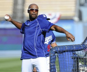 Dodgers Jimmy Rollins throws pitches during batting practice in the heatwave before game 2