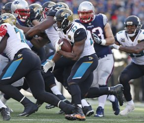 Jaguars Fournette runs against the Patriots in the AFC Championship