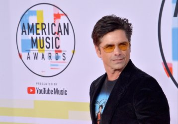 John Stamos attends 46th annual American Music Awards in Los Angeles