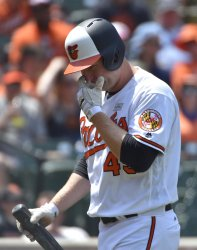 Orioles' Mark Trumbo reacts after a swinging strike out against Red Sox in 1st inning