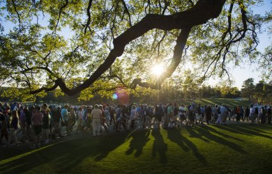 Patrons leave the grounds during the third round at the Masters